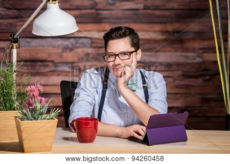 Wondering Female In Suspenders At Desk