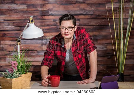 Woman Standing Behind Desk