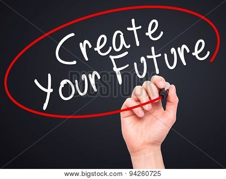Man Hand writing Create Your Future with black marker on visual screen.