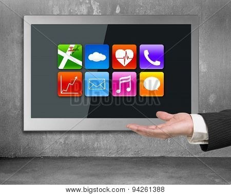 Hand Showing Black Wide Flat Tv Screen With App Icons