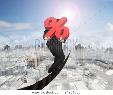 Businessman Carrying 3D Red Percentage Sign Balancing On Wire