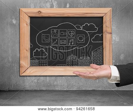 Hand Showing Blackboard With Hand-drawn App Icons On Wall