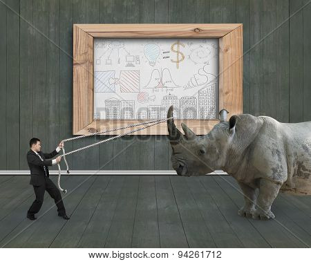 Businessman Pulling Rope Against Rhinoceros Business Concepts Doodles Whiteboard