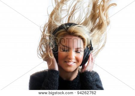 Pretty Girl Flinging Hair Listening Headphones Isolated Background