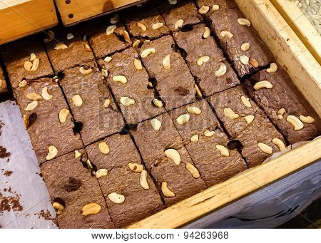 Fresh brownie in wooden tray