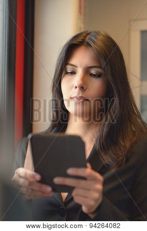 Brunette Woman Using Tablet