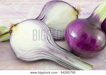 Young Garlic On A Magenta Wooden Board