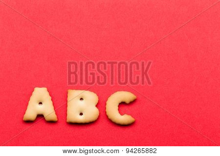ABC biscuit over the red background