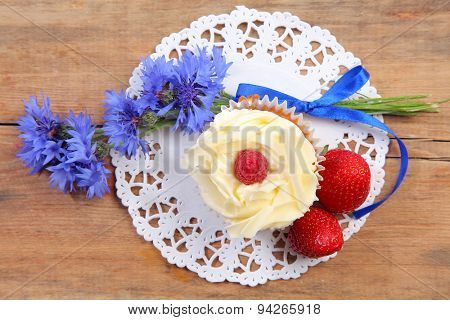 sweet cake on wooden table