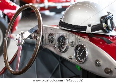 Helmet And Glasses On A Vintage Sports Car