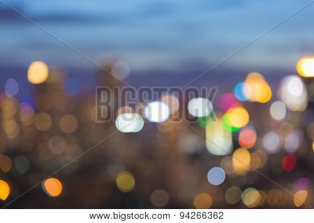 City light blur bokeh abstract defocused background during twilight