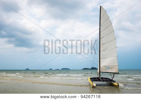 Catamaran sailboat on a tropical beach at Koh Chang island, Thailand