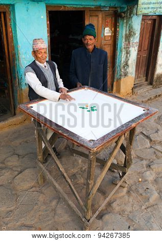 Men Playing Typical Nepalese Desk Game Carryam Board