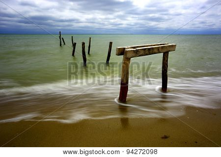 Old wooden bridger on sea coast