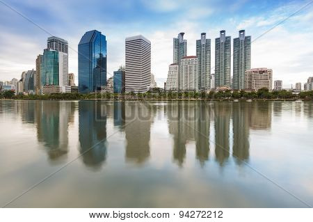 Cityscape at Bangkok Business District  twilight with water reflection Thailand