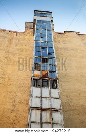External Lift Shaft With Broken Glass Segments