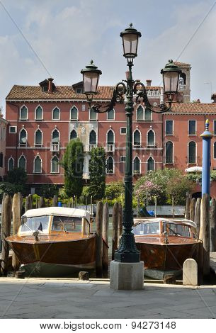 Wooden Boats In A Venice Canal