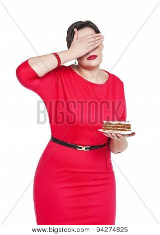 Diet And Nutrition Concept. Plus Size Woman Doesn't Want To See Cake