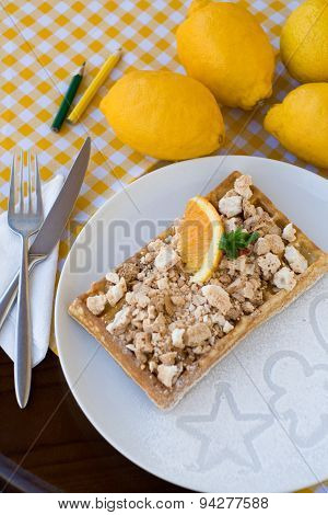Waffles With Meringue, Lemon Curls And Orange Slices For Breakfast