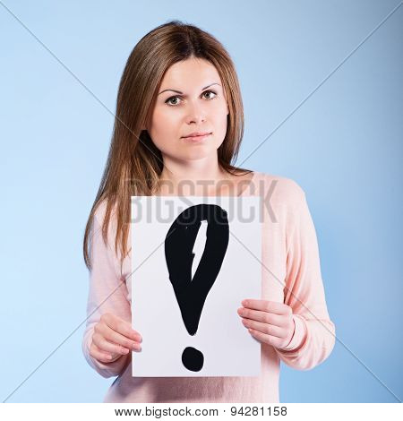 Woman Holding A Cardboard  Exclamation Mark