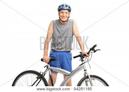Studio shot of an active senior in sportswear posing behind a bicycle isolated on white background