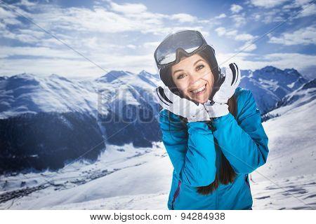 Smiling girl blue jacket alps mountain resort