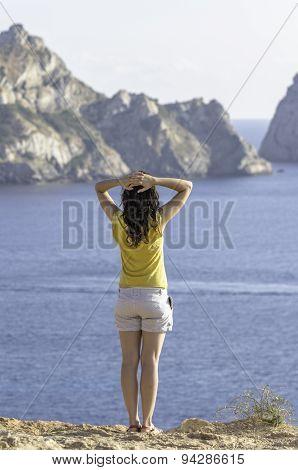 Girl Back Looking Sea And Es Vedra Ibiza, Island.