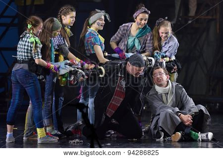 ST. PETERSBURG, RUSSIA - JUNE 19, 2015: Actor Konstantin Khabensky (right) and singer Alexey Kortnev (center) perform in a scene from a children's charity project titled Mowgli Generation