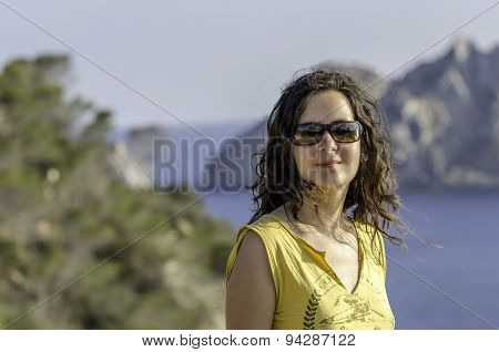 Beautiful Young Girl In Sunglasses On The Sea