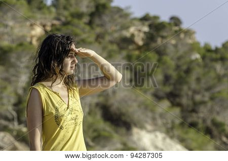 Girl With The Hand In Forehead And The Forest In The Background