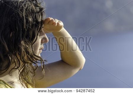 Girl Ahead With The Hand In Forehead And The Sea In The Background.