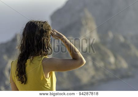 Beautiful Woman Looking Ahead With The Hand In Forehead And The Forest In The Background