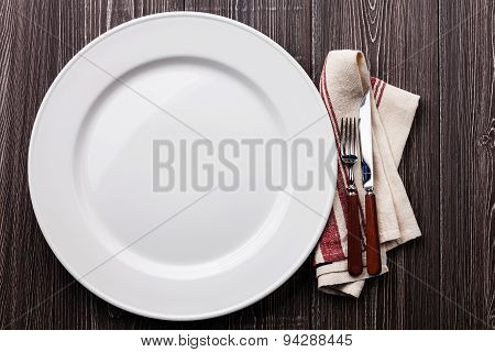 White Empty Plate With Fork And Knife On Gray Wooden Background
