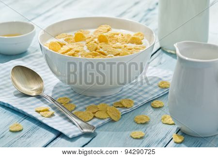 Cornflakes cereal and milk. Morning breakfast.