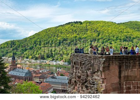 HEIDELBERG, GERMANY - APRIL 26: Overview of Town of Heidelberg on Banks of Neckar River Surrounded by Lush Green Hillsides, seen from Tourist Observation Tower at Castle, Heidelberg on April 26, 2015