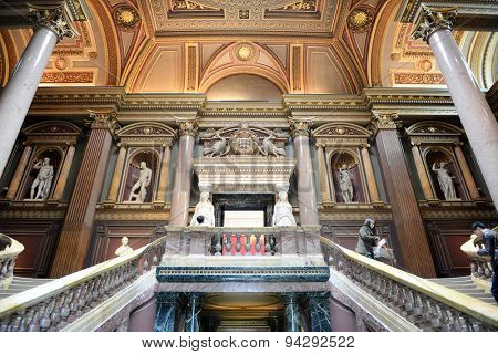 CAMBRIDGE, ENGLAND - MAY 13: Interior staircases at the Fitzwilliam Museum for antiquities and fine art at Cambridge, Engleand with historical sculptures on the wall of the landing on May 13, 2015