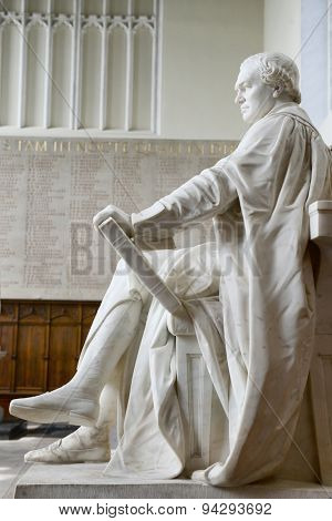 CAMBRIDGE, ENGLAND - MAY 13: Profile of Statue of William Whewell in front of World War II Memorial Inside Trinity College Chapel, Cambridge University, England on May 13, 2015