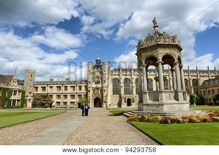 CAMBRIDGE, ENGLAND - MAY 13: Grand Court, Trinity College, Cambridge with a view of the central fountain, Kings Gate and chapel, in a travel and tourism concept on May 13, 2015