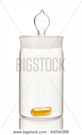Transparent jar with pill isolated on white