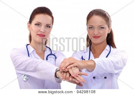 Yomg woman doctor stacking hands together over white background .
