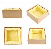 picture of foreshortening  - Opened cardboard box with the yellow cloth inside - JPG