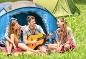 picture of threesome  - Group of best friends singing and having fun camping together  - JPG