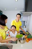 stock photo of southeast asian  - Happy asian family cooking in the kitchen - JPG