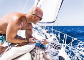 pic of work crew  - Handsome man working on sailboat - JPG