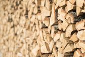stock photo of firewood  - Closeup of chopped firewood in a stack ready for burning - JPG