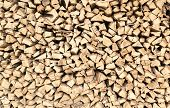picture of firewood  - Closeup of chopped firewood in a stack ready for burning - JPG