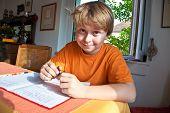 picture of homework  - boy doing homework for school at home - JPG