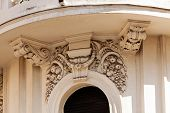 picture of stone sculpture  - stone facade on classical building with ornaments and sculptures - JPG
