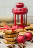 foto of christmas cookie  - Christmas Gingerbread Cookies homemade with red bow  - JPG