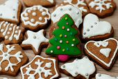 pic of christmas cookie  - Christmas Gingerbread Cookies Tree homemade on wooden table - JPG